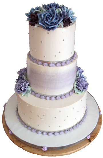 3 Tier Ercream Wedding Cake Decorated With Diffe Shades Of Purple Lilac Sugar Roses