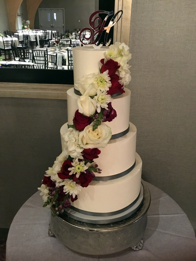 Buttercream wedding cakes york pa buttercream wedding cakes 4 tier buttercream wedding cake decorated with an assortment of cascading red and white fresh flowers junglespirit Choice Image