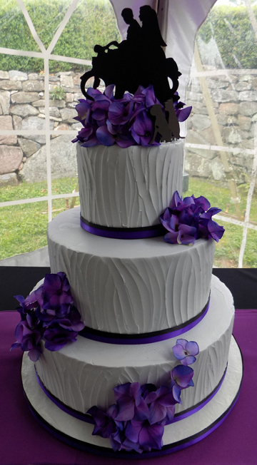 Three Tier Buttercream Wedding Cake Iced With Textured Light Grey Vanilla And Decorated Black Purples Ribbons As Well Silk Purple