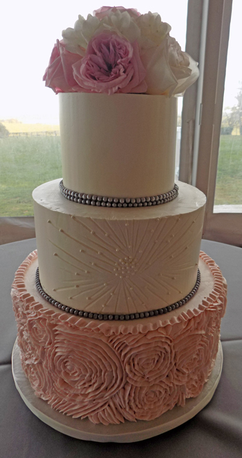 3 Tier Buttercream Wedding Cake Decorated With Blush Pink Ruffles Pleats
