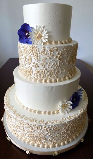 4 Tier Ivory Ercream Wedding Cake Decorated With Champagne Colored Lace And Handmade Sugar