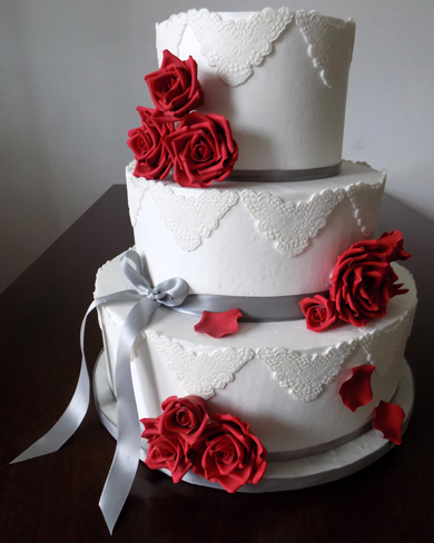 3 Tier Ercream Wedding Cake Decorated With Silver Ribbons White Fondant Lace Liques And Hand Made Red Gumpaste Sugar Roses