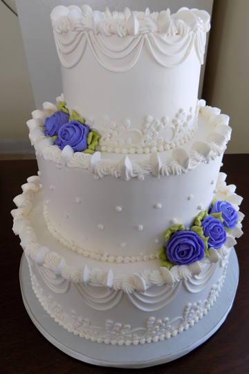 3 Tier Ercream Wedding Cake Decorated With Drop Strings Swiss Dots And Lilac Light Purple Roses