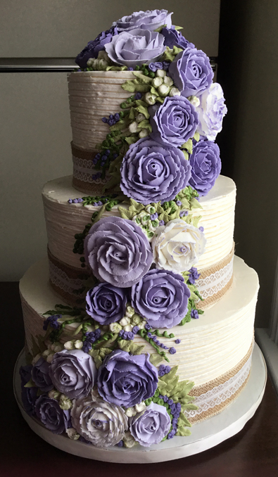 3 Tier Rustic Textured Buttercream Wedding Cake Decorated With Burlap And Lace Ribbons An Assortment Of Cascading Lilac Flowers