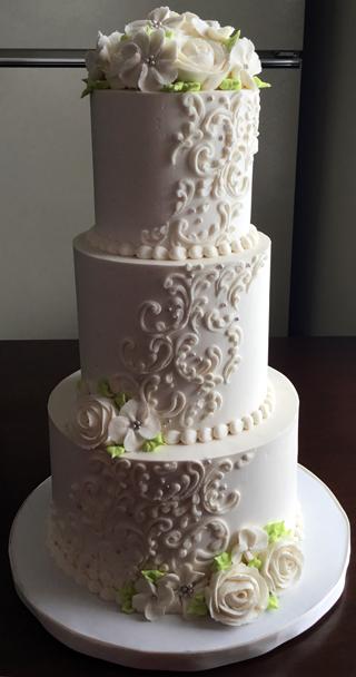 3 Tier Ercream Wedding Cake Decorated With Cascading Scrolls Sugar Pearls