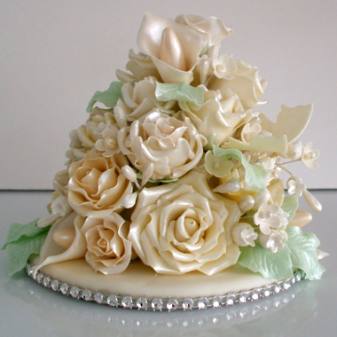 Hand made wedding cake topper of assorted off white flowers