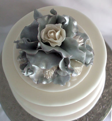 Top view of hand made silver southern magnolia and white roses