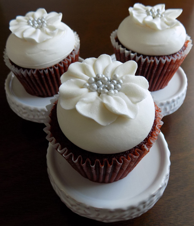 Red velvet cupcakes, filled with cream cheese icing, topped with vanilla buttercream and decorated with white buttercream fantasy flowers with edible silver pearl centers delivered at the Peter Allen House in Dauphin PA