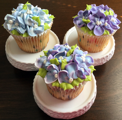 Confetti/funfetti cupcakes, filled with vanilla buttercream and decorated with buttercream hydrangeas delivered at the Wyndridge Farm Dallastown PA