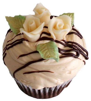 Chocolate cupcake filled with vanilla buttercream, topped with caramel buttercream and ganache drizzles and decorated with chocolate flowers