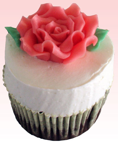 Chocolate cupcakes topped with a peach rose made of chocolate