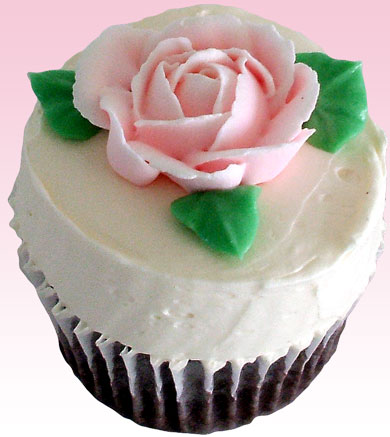 Chocolate cupcakes with pink royal icing rose