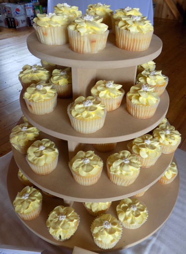 Lemon cupcakes, filled with lemon buttercream and decorated with yellow vanilla buttercream flowers. Cupcakes Monkton MD