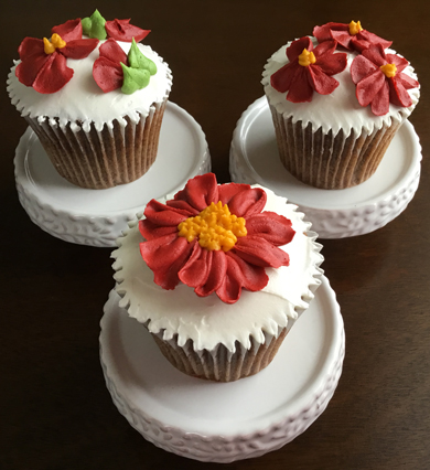 German chocolate cupcakes, filled with coconut pecan icing, iced with vanilla buttercream and decorated with deep red buttercream flowers delivered at Acorn Meadows in Thomasville PA