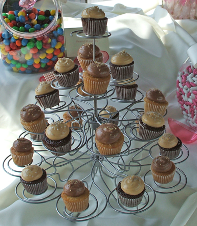 Mini caramel cupcakes topped with chocolate buttercream and mini chocolate cupcakes topped with peanut butter icing