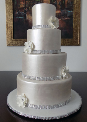 4 Tier Pearl Metallic Wedding Cake Decorated With Diamond Bling Ribbons And White Fantasy Flowers